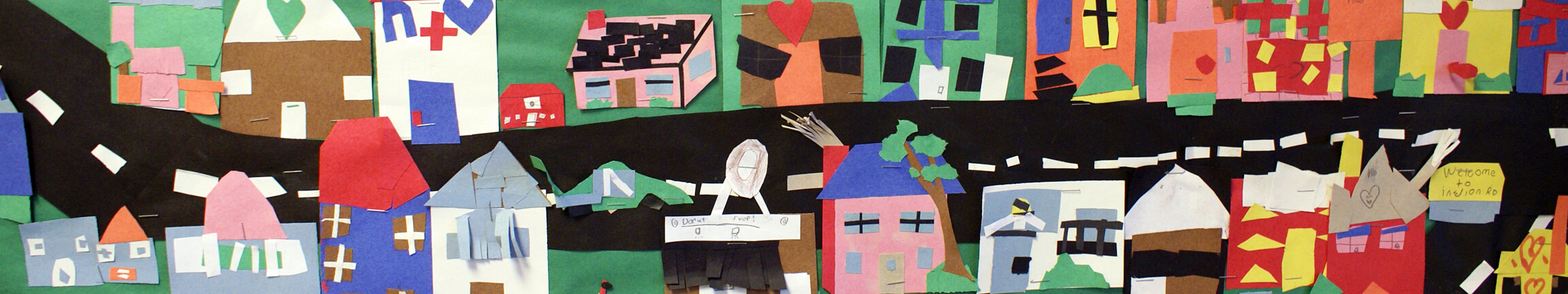 Consturction paper street collage made by local students.